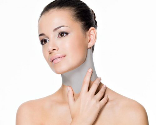 15871599 - beautiful woman cares of neck- posing at studio  isolated on white
